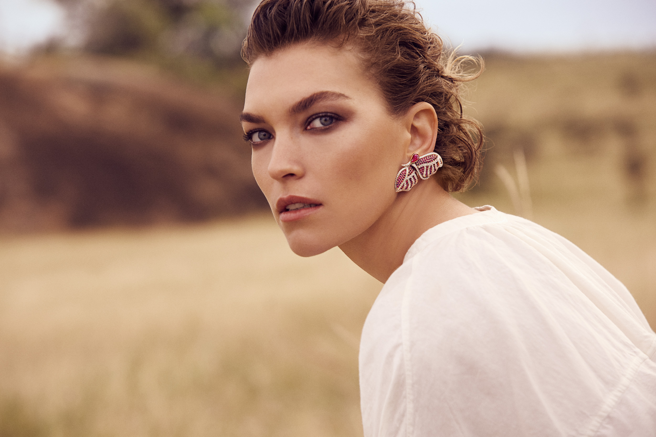 Image Credits: 'Walk For Giants', photography by Francesco Carrozzini, creative direction by Riccardo Ruini, shot on location at Enasoit Game Sanctuary, featuring Fehmida Lakhany X Gemfields Butterfly Earrings